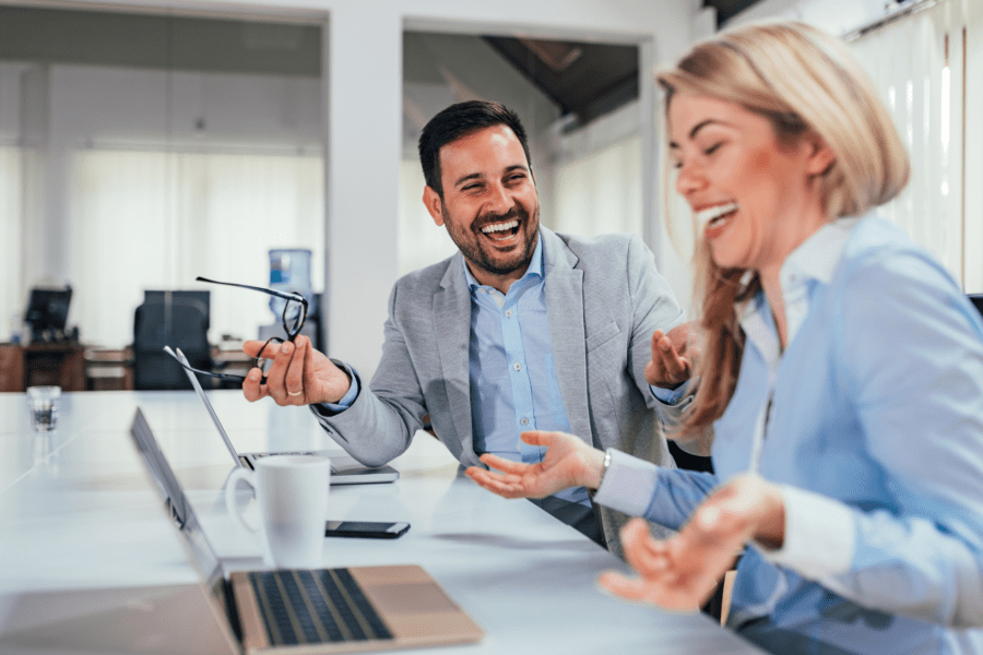 colleagues-laughing-stay-happy-at-work